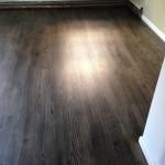 Ebony floor coated with Bona Traffic HD -
