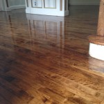 We water popped this Maple to floor and applied chestnut stain.  The posts are also done with chestnut stain.