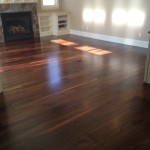 We refinished this beautiful wide plank American Black Walnut floor with four coats of oil base polyurethane.
